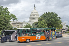 Tour buses pass the U.S. Capitol on a cloudy day (Tim Brown's Pictures) Tags: washingtondc capitolhill summer travel uscapitol capitoldome eastfrontuscapitol tourbus tourists rainyday cloudyday grayskies washington dc unitedstates