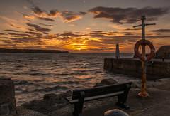 A Cullen Sunset (williamrandle) Tags: morayfirthcullen banffshire moray scotland northeastscotland uk summer 2018 sunset lowlight clouds sky colour golden water sea waves harbour stone beauty serene nikon d7100 sigma1835mmf18art seascape