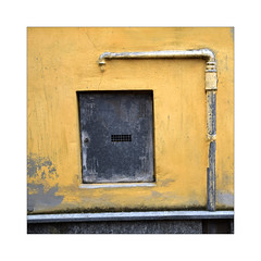 Italian Wall Stories (YIP2) Tags: street windows city urban minimal minimalism line lines stripes simple less linea detail geometry pattern design white yellow details abstract construction urbandetail texture surface outside building wall cuneo piedmont piemonte italy italia travel