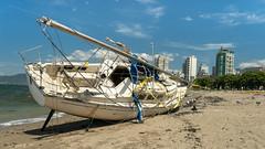 Shipwrecked (Sworldguy) Tags: sailboat englishbay wrecked shoreline sand abandoned vancouver ashore battered
