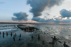 Stranded on the mudflats (powerfocusfotografie) Tags: mudflat wreck shipwreck tide lowtide waddensea friesland evening eveninglight sunset dusk outdoors clouds nature landscape dike henk nikond90 powerfocusfotografie