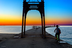 Bike the Pier (Andy Marfia) Tags: chicago uptown pier montrosepier montrosebeach lakemichigan lakefront sunset sky water bike cycling people d7100 1685mm 1100sec f56 iso110
