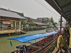 Amphawa floating market in the rain in Samut Songkhram province in Thailand (UweBKK (α 77 on )) Tags: amphawa floating market rain downpour rainy season boat canal mae klong river samut songkhram thailand southeast asia iphone