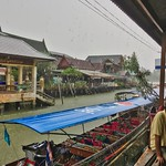 Amphawa floating market in the rain in Samut Songkhram province in Thailand thumbnail