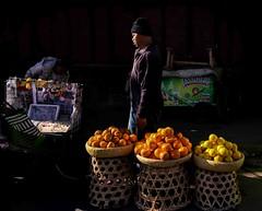 Market Morning (Rod Waddington) Tags: africa african afrique afrika madagascar malagasy antananarivo tana morning light market stall fruit citrus mandarin lemon man outdoor culture cultural ethnic ethnicity