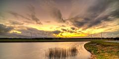 Clouds trekking west to find a better future. (Alex-de-Haas) Tags: 11mm d850 dutch hdr holland irix nederland nederlands netherlands nikon noordholland noordhollandschkanaal schoorldam avond beautiful beauty canal cloud clouds evening hemel kanaal landscape landschap longexposure lucht mooi skies sky sundown sunset water winter wolk wolken zonsondergang