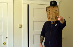 Bagman 1 (TheseusPhoto) Tags: silly man tattoos hoodie point bag face fun drawing indoors pose