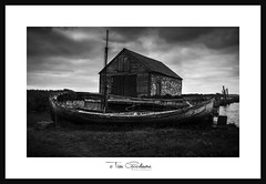 The waves of time wash over us all! (timgoodacre) Tags: boat boating boats wreck shipwreck ship ships sea seaside water ngc blackwhite blackandwhite monochrome mono bay grass grassland building sky clouds cloud landscape