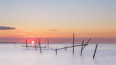 Just before the sun set in the sea and ... (karindebruin) Tags: goereeoverflakkee nederland stellendam thenetherlands visnetten zonsondergang zuidholland fishingnets sunset water