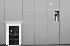 Trois regards sur l'architecture à Rouen I/III : ne pleurez pas, c'est juste pour rire... :). (stephane.desire) Tags: rouen architecture porte moderne monochrome noiretblanc vasistas ville façade maison grandangle