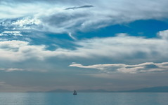 Aqua (ranssom.) Tags: sea boat sky clouds blue calm inexplore greece ocean water