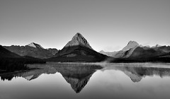 You Can't Explain the Impulse (Black & White, Glacier National Park) (thor_mark ) Tags: arête balconyview blackwhite blueskies capturenx2edited centralmontanarockymountains colorefexpro day13 glaciernationalpark glaciernationalparkranges glassreflections grinnellpoint lake lakereflectionsonwater landscape lewisrange lookingsw lookingtomountainsofthecontinentaldivide mountgould mountwilbur mountains mountainsindistance mountainsoffindistance nature nikond800e northernlewisrange outside reflectionsonlake reflectionsonwater rockymountains sunrise swiftcurrentlake swiftcurrentlakevicinity swiftcurrentlakeandnearbyarea trees waterreflections waterreflectionsofmountains watertonglacierinternationalpeacepark worldheritagesite azimuth244 poetryandprose freeversepoetry canvas portfolio project365 montana unitedstates
