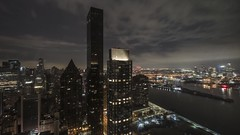 East River Night to Day Time Lapse (Michael.Lee.Pics.NYC) Tags: newyork aerial video timelapse millenniumhiltonunplaza unplaza night sunrise dawn bluehour clouds sky eastriver uppereastside rooseveltisland queens astoria architecture cityscape skyline sony a6500 voigtlanderheliar10mmf56