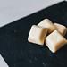 Cubes of white chocolate Schogetten on dark background