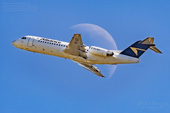 VH-QQY Alliance Airlines Fokker70 Crosses the Waning Crescent Moon 32.1%. (ePixel Images) Tags: vhqqy allianceairlines fokker70 waningcrescentmoon moon brisbane brisbaneairport bne sky blue flight aircraft transport travel