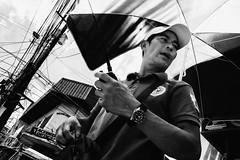 10:40 (Meljoe San Diego) Tags: meljoesandiego ricoh grd4 grdiv streetphotography umbrella candid monochrome philippines watch