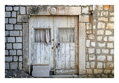Old Door (Jocelyn777) Tags: stone stonehouses architecture doors doorsandwindows weathered weathereddoorsandwindows abandoned houses lopud lopudisland dalmatia croatia balkans travel white minimal