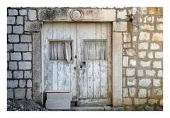 Old Door (Jocelyn777) Tags: stone stonehouses architecture doors doorsandwindows weathered weathereddoorsandwindows abandoned houses lopud lopudisland dalmatia croatia balkans travel white minimal