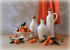 Movement of Colors (Esther Spektor - Thanks for 12+millions views..) Tags: stilllife naturemorte bodegon naturezamorta stilleben naturamorta composition creativephotography art tabletop bottle stand food citrus kumquat leaf curtain ceramics ambientlight white orange green beige estherspektor canon