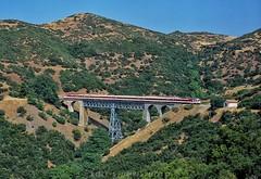 Km 248 bridge at Karya (rolfstumpf) Tags: greece karya othris mountains ose organismossidirodromonellados aeg ic2000n trains passengertrain dmu bridge landscape summer mamiya fujichrome