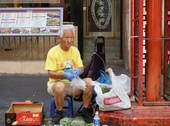 Street vendor, Chinatown, London (Yekkes) Tags: london chinatown soho gerrardstreet street city urban chinese vendor salesman old elderly experienced dignified working senior whitehair