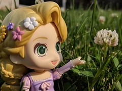 Looking at the clover (ThefoxyPickles) Tags: rapunzel disney nendoroid miniature miniaturephotography toy amaturephotography nature