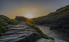 Boscastle Harbour Sunset..... (johngregory250666) Tags: swcoastpath cornwalluk coast coastal path south west trail devon atlantic heartland point nikon d5200 nikkor 1024 summer june uk surf waves green blue water sky country landscape orange sea bay bluff cliff ocean grass rock beach animal people photoadd boscastle harbour mountainside