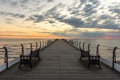 Muted Morning (Dean Conley) Tags: saltburnbythesea nikon nikond7200 sunrise morning saltburnpier pier northsea northeastengland northeastcoast coast sea clouds sun deanconley tokina1120mmf28 bench wood sky