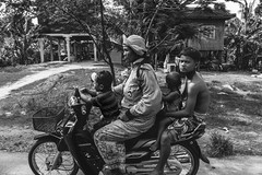 Cambodian Family on Motorcycle (shapeshift) Tags: rawformat raw rawphoto rawphotography candidphotography streetphotography transport transportation siemreap travel rural people davidpham davidphamsf shapeshift shapeshiftnet family scooters motorcycle road countryroad countryside siemreapprovince cambodia kh blackandwhite bw picturestory storypicture documentary