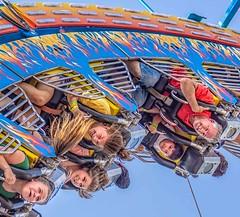 Summer Fun (Wes Iversen) Tags: clichesaturday davisburg hcs michigan nikkor18300mm oaklandcountyfair upsidedown carnival carnivalrides expressions hair kids men people rides
