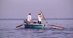 early fishing ... (momirage) Tags: fishing fishermen fisherman stick shore morning early alexandria egypt teamwork reflection drops