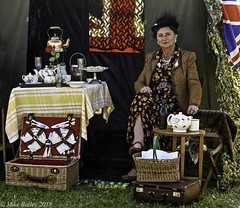 Tea Anyone??? (MWBee) Tags: actor cosford raf rafcosford cosfordairshow2018 mwbee nikon d750 lady tea teaset picnichamper table kettle cakes tent chair hat coat teapot bottle smile