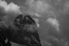 Monstre Sacré (Frédéric Fossard) Tags: monochrome noiretblanc blackandwhite sky mountain landscape hautemontagne aiguillesrocheuse nuages clouds lesdrus nichedesdrus couloirnord sommet mountainpeaks cimes crêtes arêtes rocher alpes hautesavoie glacier neige snow facenord chamonix mountaintop picdemontagne breathtakinglandscapes