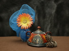 Still Life with Big Orange Flower (N.the.Kudzu) Tags: tabletop stilllife vase stew pot scarf flower pine cones canon70d manualfocus primelens russianlens flash