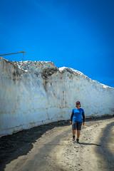 Amanda hiking beside the snow walls.