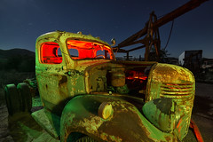 green with envy. 2018. (eyetwist) Tags: eyetwistkevinballuff eyetwist night truck rusty patina decay retired junkyard desert california nikon d7000 nikkor capturenx2 1024mmf3545g 1024mm fullmoon dark longexposure moonlight npy nocturne lightpainting protomachines flashlight wideangle stars startrails wrecked faded weathered dusty americanwest vintage green red yellow rust junk hood grille bumper pickup