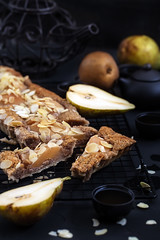Pear frangipane tart (Speleolog) Tags: food sweet pie pear dessert cake tart pastry delicious fruit baked autumn sugar meal french almond tasty tarte frangipane fall vegetarian homemade eating crust gourmet tatin caramel nuts recipe cookery lunch key golden custard caramelized cream vegan morning closeup breakfast wine yellow serving dark cooking tea teapot black low background