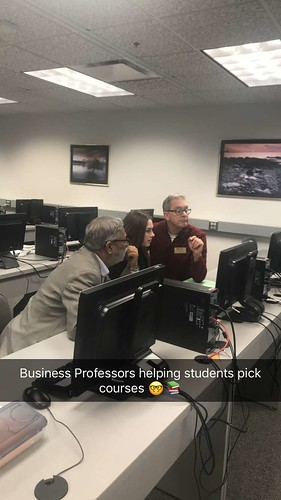 Business professors helping students