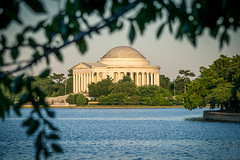 Glimpse of the Possible (dayman1776) Tags: washington dc jefferson memorial sunset trees cherry blossoms framed golden hour monument thomas capital usa america american tidal basin water