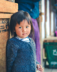 A cute baby girl in Bhutan! (1.5+ mil views. Humbled and thanks to all!) Tags: bhutan travel explore baby girl asianorigin beautiful face 50mm localpeople bluesweater yak wool clothing bigeyes
