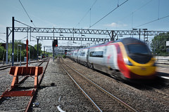390154 (Lewis_Hurley) Tags: arty blur england uk warwickshire electricmultipleunit matthewflinders emu electric station nuneaton westcoastmainline wcml virgintrains virgin pendolino class390 390154 390