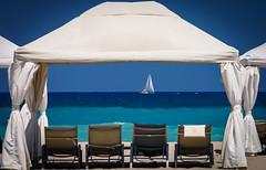 Seats with a view! (Kostas Karageorgiou) Tags: breeze blue turquoise turquoisewaters sailingboat yacht sailing gazebo sand greece aegeansea beach ef70200f28lisiiusm canon5dmkiv crete vacations summer grecotel