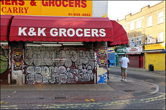 Sniper / Xpac (Alex Ellison) Tags: shop store shutter southlondon urban graffiti graff boobs
