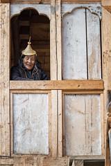 Old Layap woman at the window of her house - Laya - Gasa District - Snowman Trek - Bhutan (PascalBo) Tags: nikon d500 asie asia southasia asiedusud drukyul drukgyalkhap bhutan bhoutan འབྲུག་ཡུལ། འབྲུག་རྒྱལ་ཁབ་ snowman trek trekking hike hiking lunana gasa himalaya himalayas jigmedorjinationalpark laya layap indigenous people woman femme hat chapeau window fenêtre indoor indoors pascalboegli