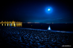 Night Heaven in Hel (Krysper) Tags: sky harbor beach night moon sea texture lights reflection clouds stars sand