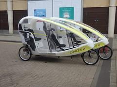 Clinque Pure Genius - three wheeled vehicle - Edgbaston Street, Birmingham (ell brown) Tags: bullring birmingham westmidlands england unitedkingdom greatbritain edgbastonst bullringmarkets indoormarket clinque puregenius threewheeledvehicle taxi taxirank rickshaw rickshaws peddlecar birminghamuk