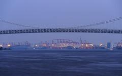Tokyo Bay (B Lucava) Tags: tokyo tokyobay rainbowbridge sea bridge blue dock ocean sky water bay longexposure
