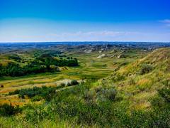ND Dakota Badlands on a sunny day (Shawn Blanchard) Tags: badlands nd north dakota western oil fields tourism park green blue sky clouds trees water prairie grass landscape field
