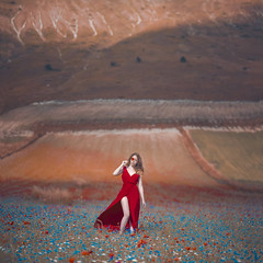 Only in the winds (W. Follies) Tags: wfollies francescaciavarella sleepersproject portrait flowers nikon italy castelluccio landscape nature paesaggio portraiture fineart colors red redhair model girl love art photography womanphotography