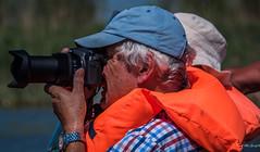 2018 - Romania - Danube Delta - Sfântu Gheorghe - Wetlands (Ted's photos - For Me & You) Tags: 2018 avalonwaterways cropped nikon nikond750 nikonfx romania tedmcgrath tedsphotos vignetting sfantughoerghe sfantughoergheromania photographer camera ballcap vest orangevest lifevest lumix bokeh lens zoomlens aiming